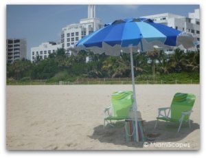 Beach scene: chairs and umbrella