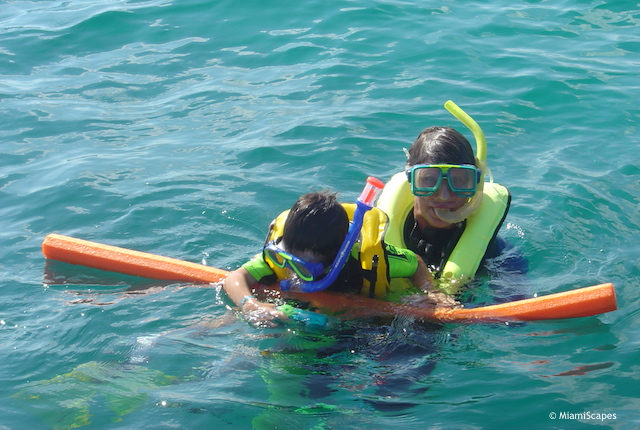 Snorkeling with kids: get a floating sausage for support
