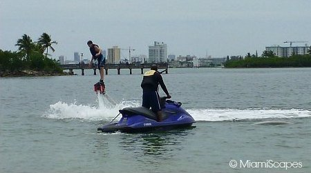 Flyboard hose connects to jetski that provides the propulsion